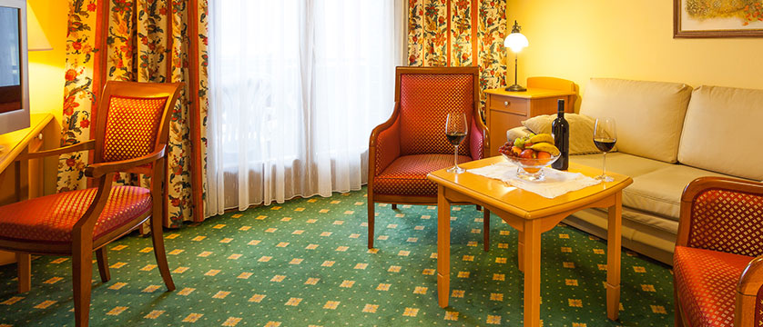 Landhotel St. Georg, Zell am See, Austria - 2 room suite seating area.jpg